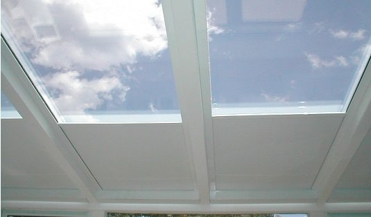 Motorized skylight roller shades